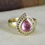 A Pear Shape Pink Sapphire & Pave Set Cinnamon Diamond Yellow Gold Halo Ring